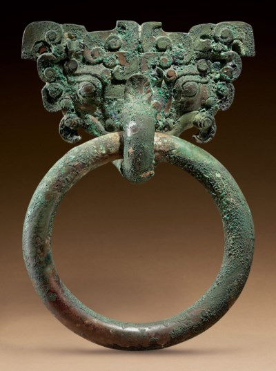 A LARGE BRONZE TAOTIE MASK AND