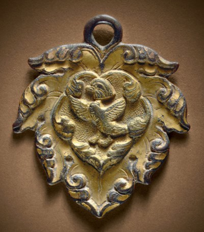 A GILT-BRONZE LEAF-SHAPED HORS