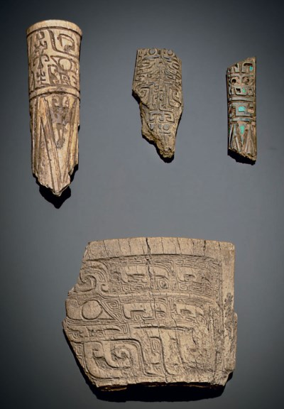FOUR CARVED BONE FRAGMENTS