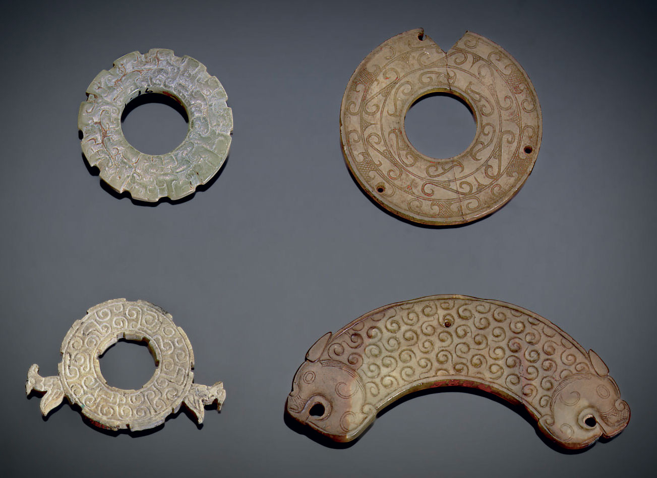 FOUR SMALL JADE ORNAMENTS