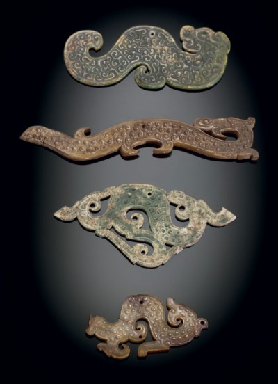 FOUR JADE DRAGON-FORM PENDANTS