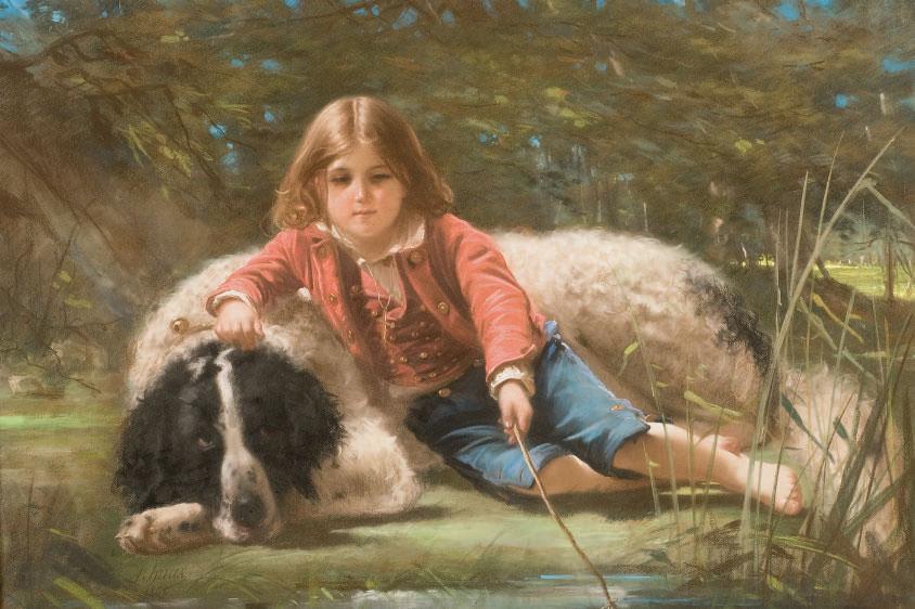 Garçon pêchant avec son chien