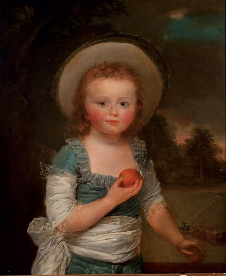Portrait d'un enfant tenant des fruits