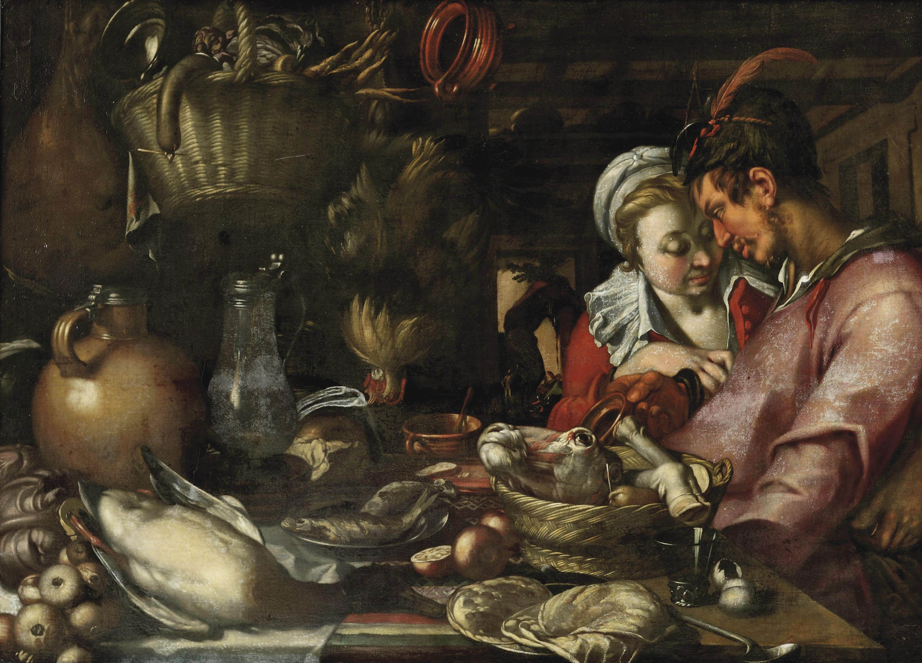 A kitchen still life with a couple standing beside a table with an elaborate display of meat, fish, vegetables and fruit