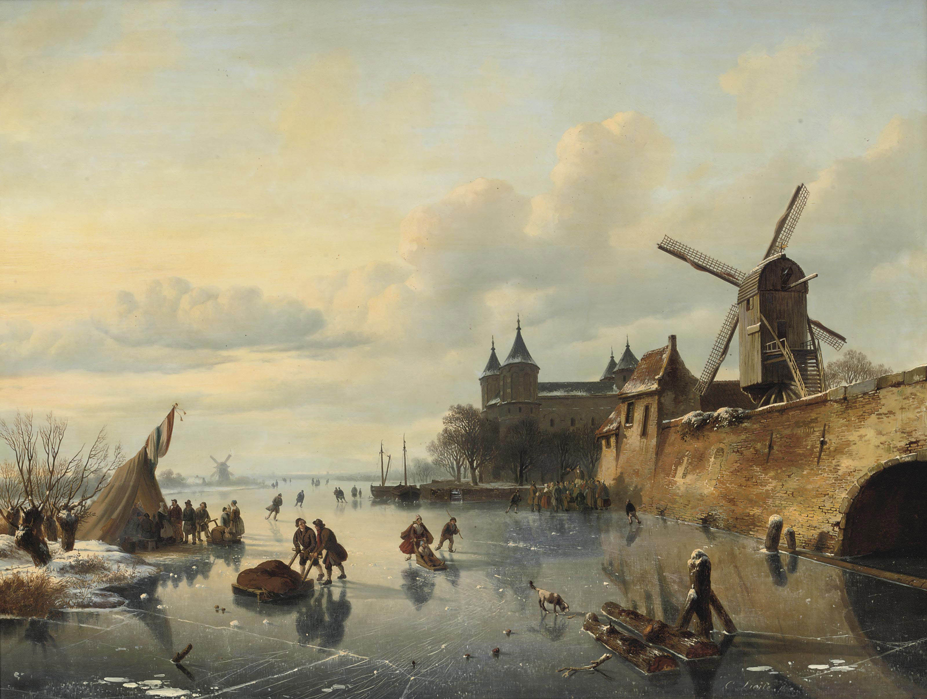 A winter landscape with skaters near a Dutch town
