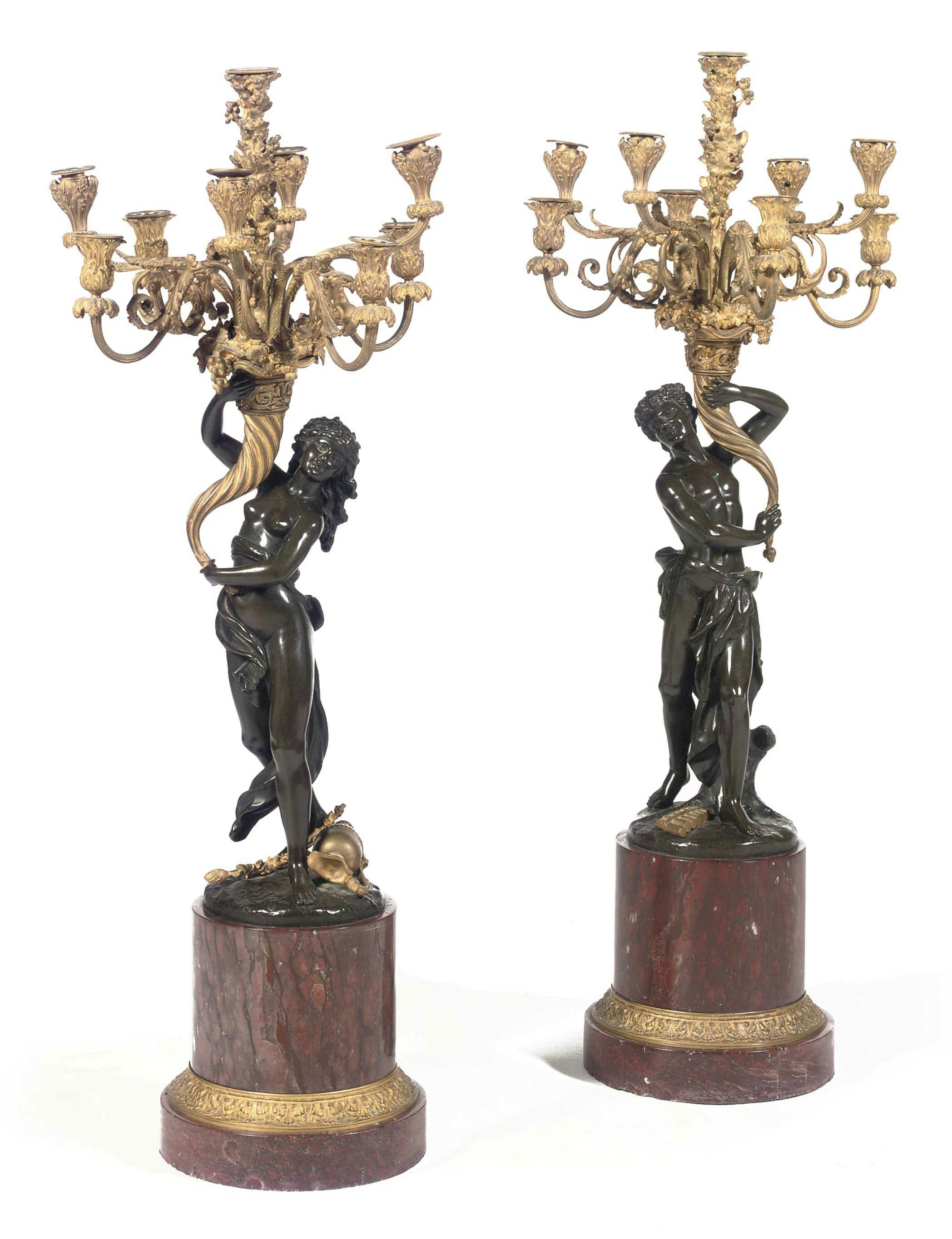 A PAIR OF FRENCH ORMOLU AND PATINATED BRONZE NINE-LIGHT FIGURAL CANDELABRA