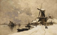 Windmills along a canal in winter