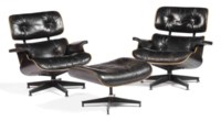 TWO BLACK LAMINATED OAK AND ALUMINUM 'MODEL NO. 670' LOUNGE CHAIRS AND ONE 'MODEL NO.671' OTTOMAN