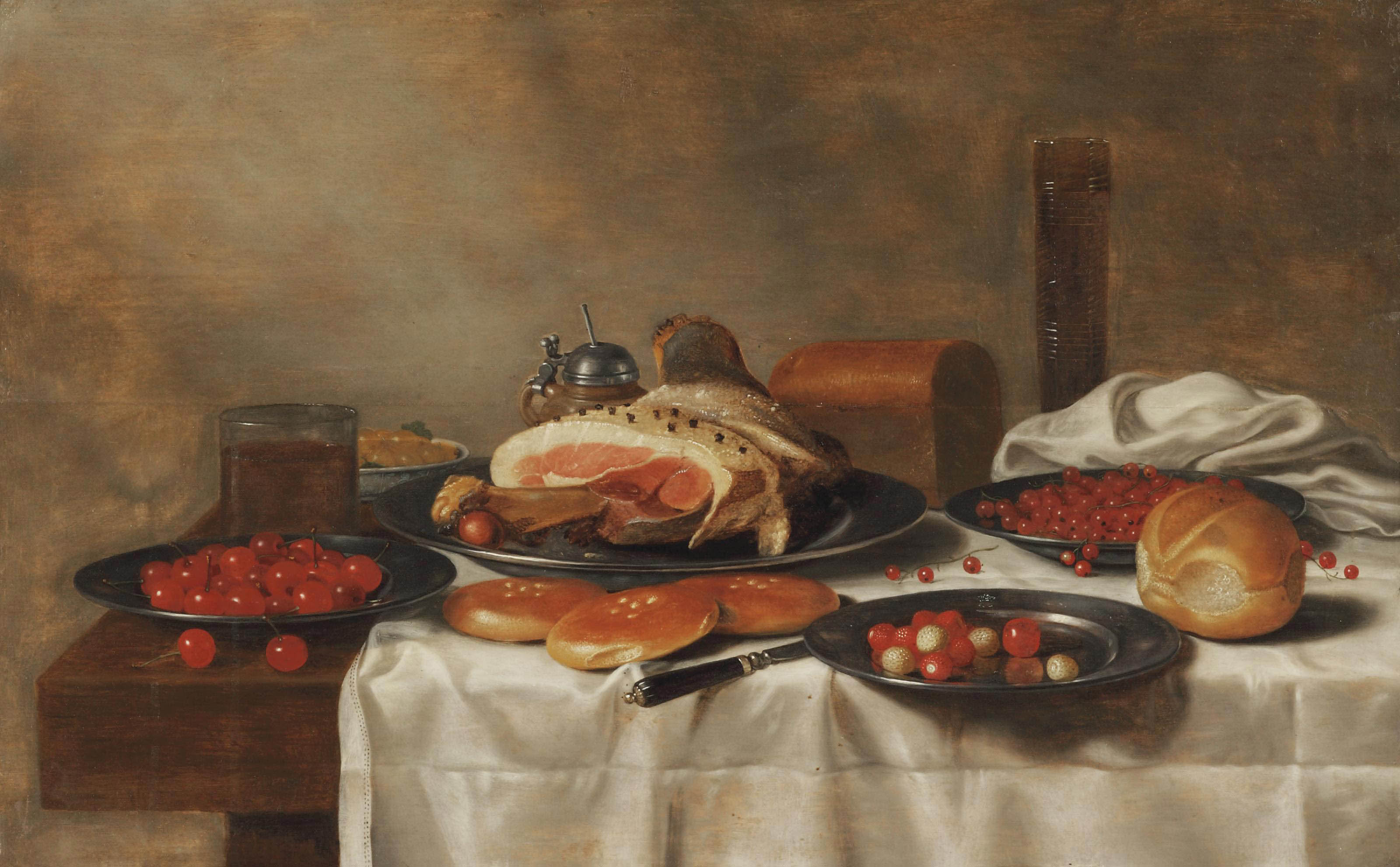 A ham on a silver plate, a glass of beer, a mustard pot and white grapes on a porcelain plate, cherries, strawberries and red currants on silver plates, rolls of bread, a knife and a 'pasglas', all on a partially draped table