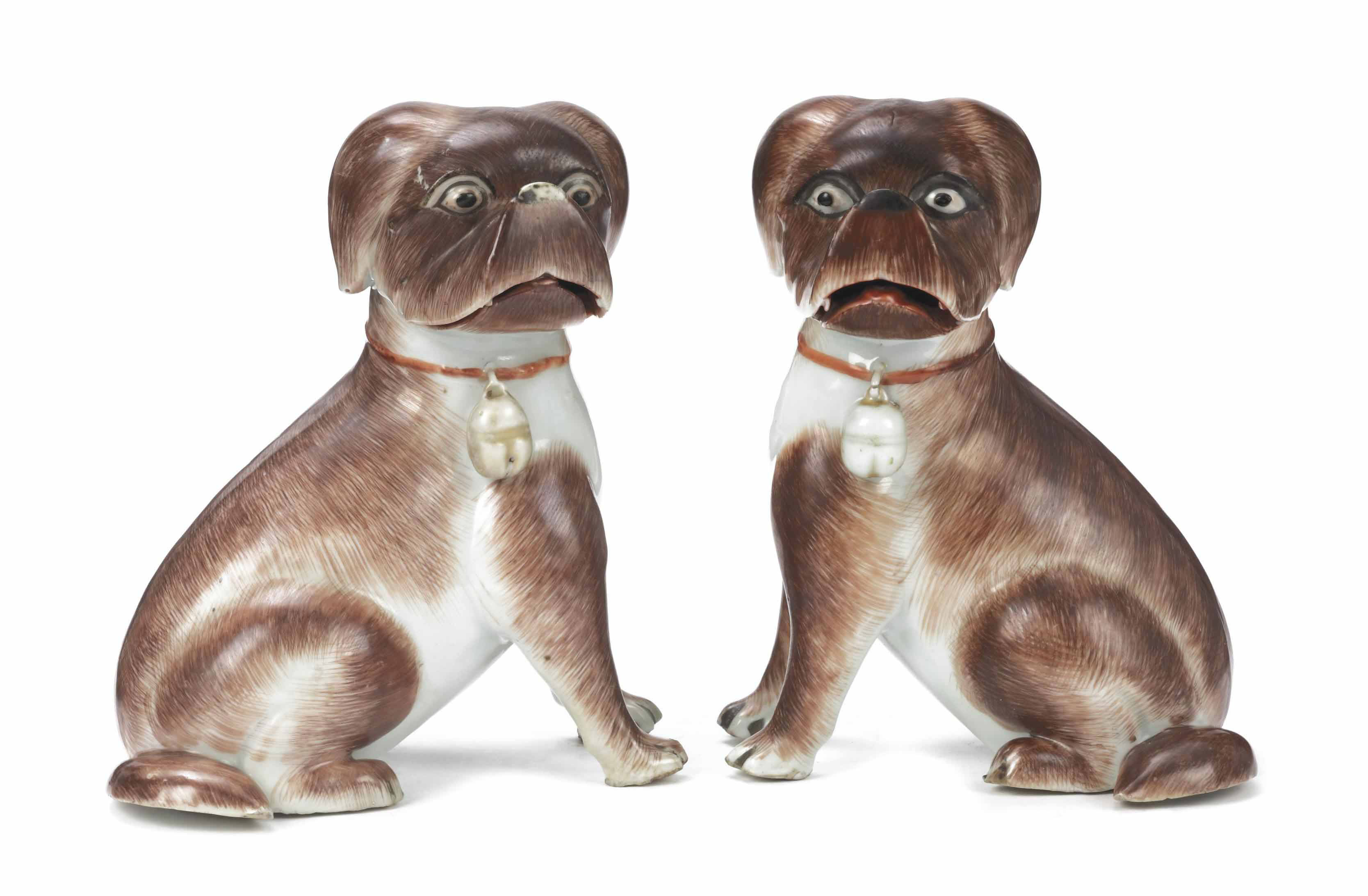 A RARE PAIR OF CHINESE EXPORT FIGURES OF SEATED PUG DOGS