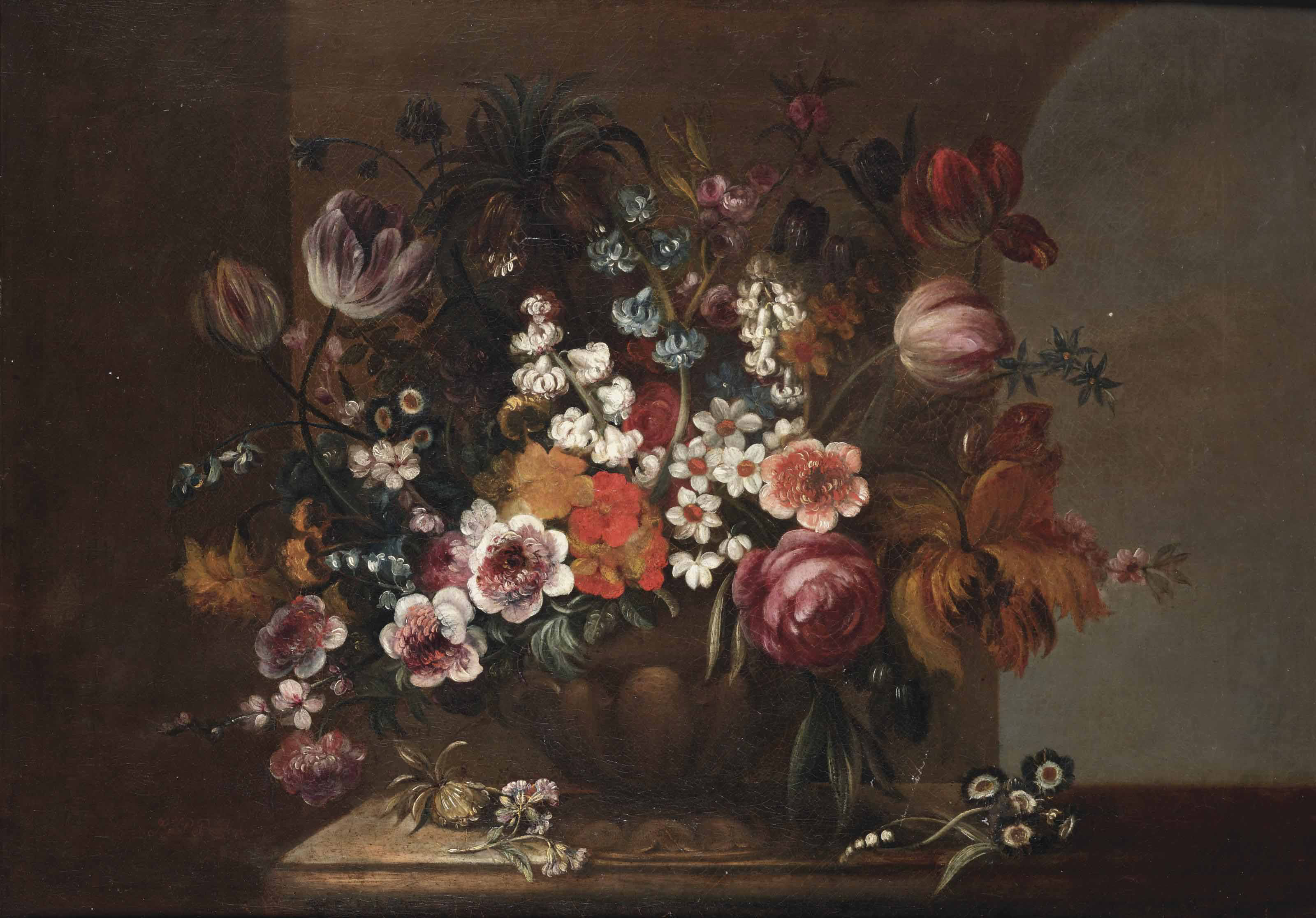 Tulips, roses, violets and other flowers in a sculpted vase on a stone ledge