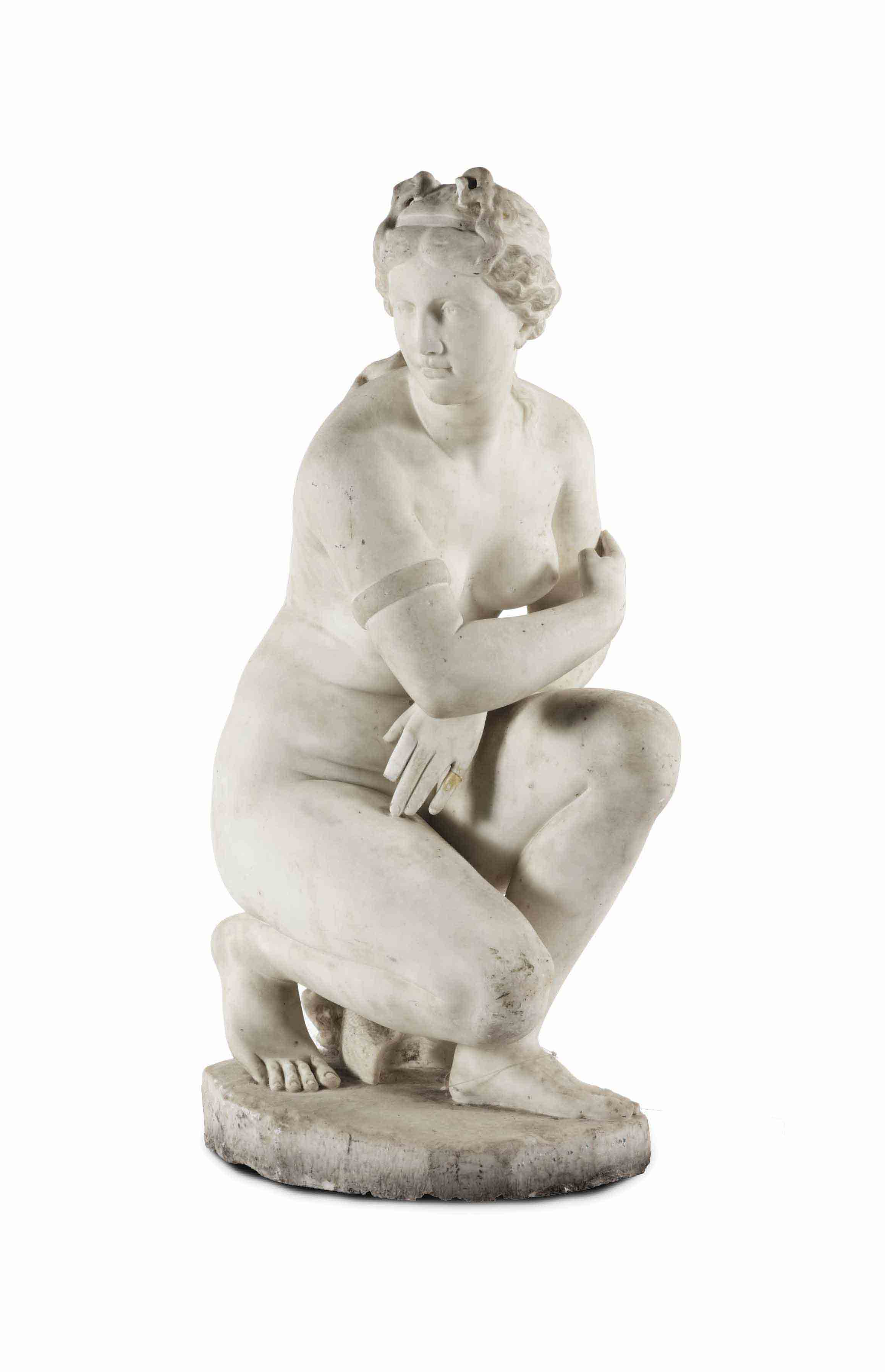 A CARVED WHITE MARBLE FIGURE O