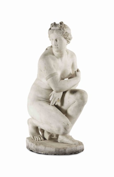 A Carved White Marble Figure Of The Crouching Venus