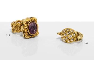 AN INDIAN DIAMOND-SET GOLD RIN