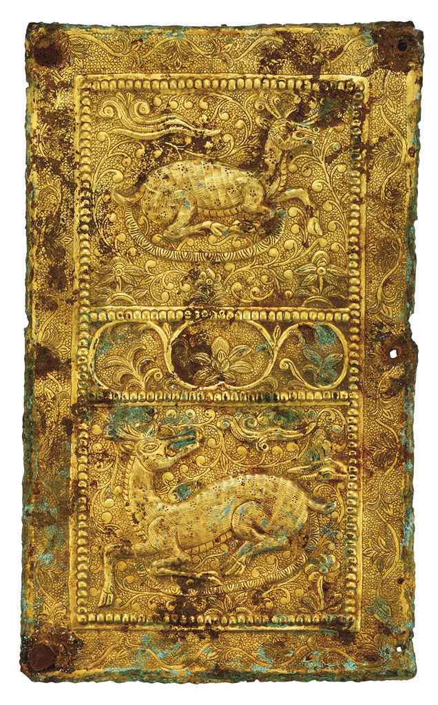 A GILT-COPPER PLAQUE