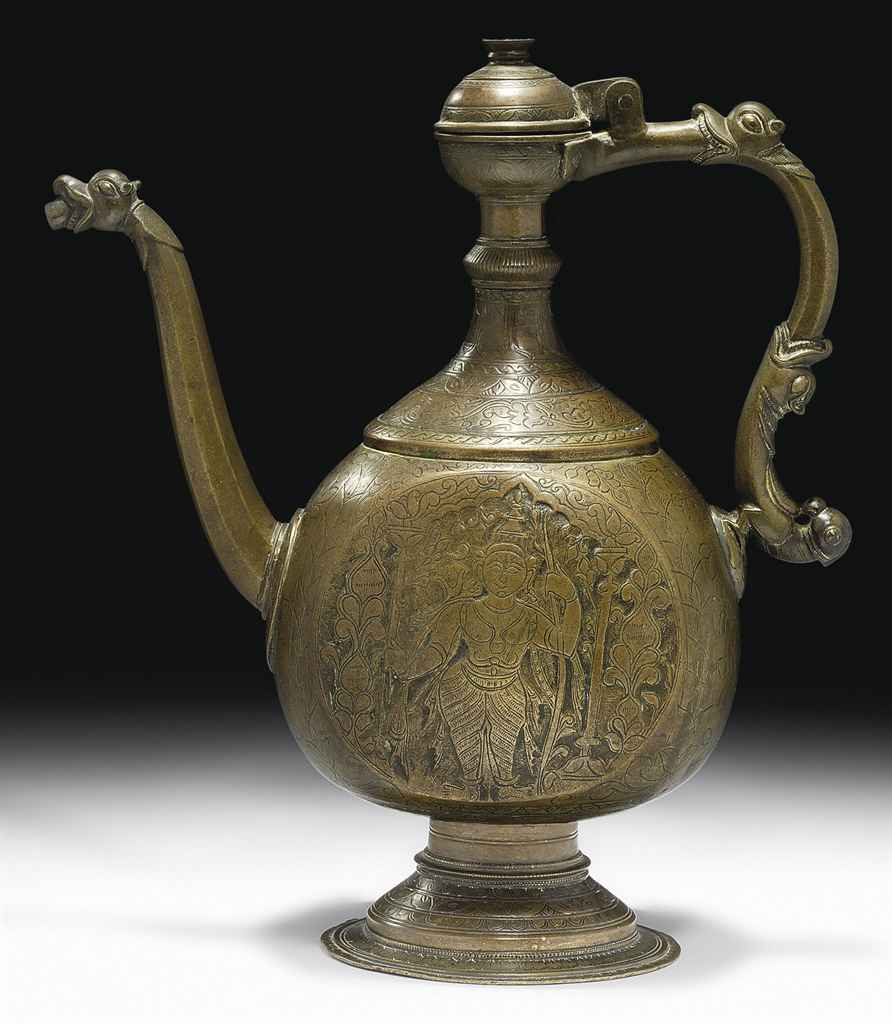 A LARGE ENGRAVED BRONZE EWER
