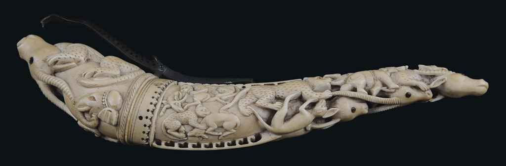 A CARVED INDIAN IVORY POWDER H
