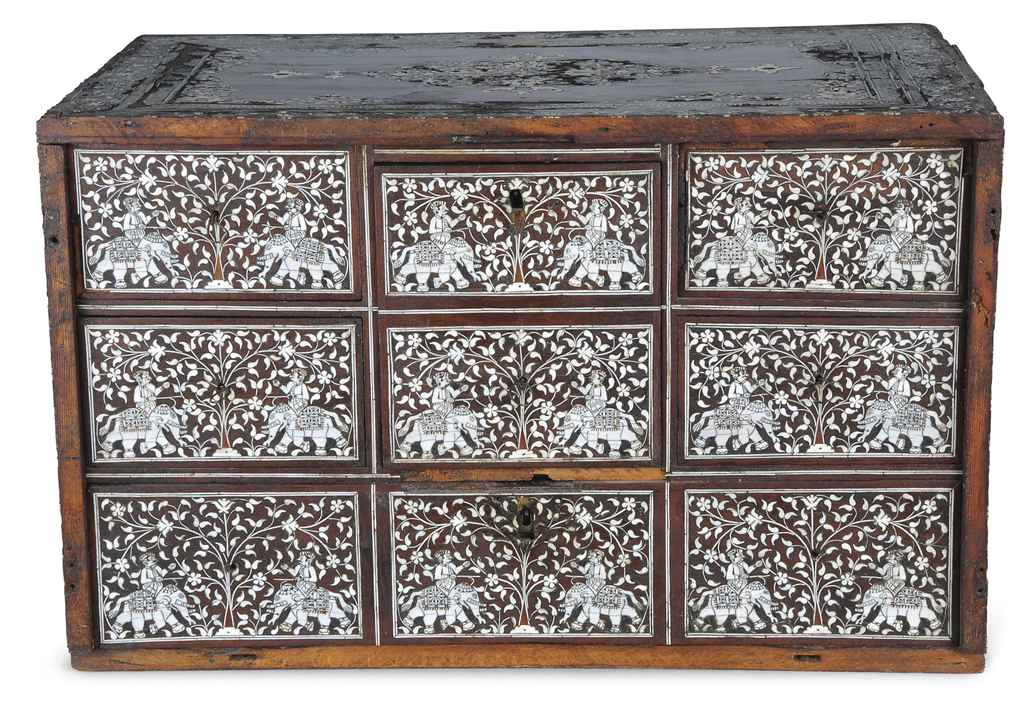 AN IVORY INLAID WOODEN CASKET