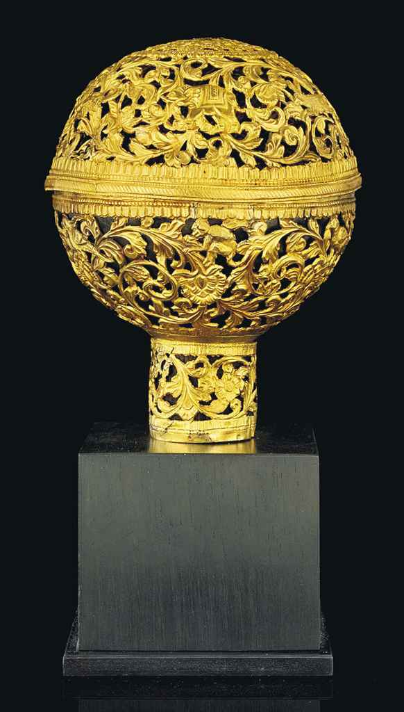 AN OPENWORK AND REPOUSSE GOLD