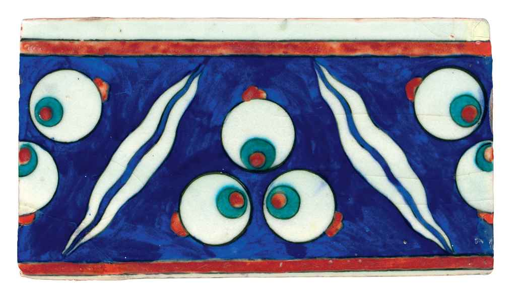 A LARGE IZNIK POTTERY BORDER T