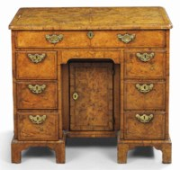 A GEORGE II WALNUT AND BURR WALNUT KNEEHOLE DRESSING-TABLE