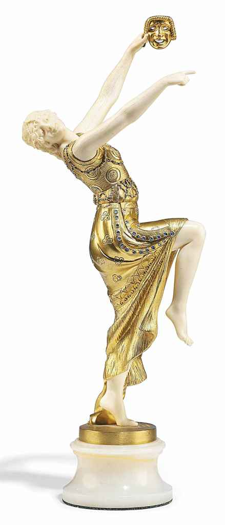 A FRENCH IVORY AND BLUE-PAINTED GILT-BRONZE FIGURE OF A DANCER