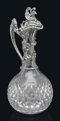 A SILVER MOUNTED CUT-GLASS DECANTER