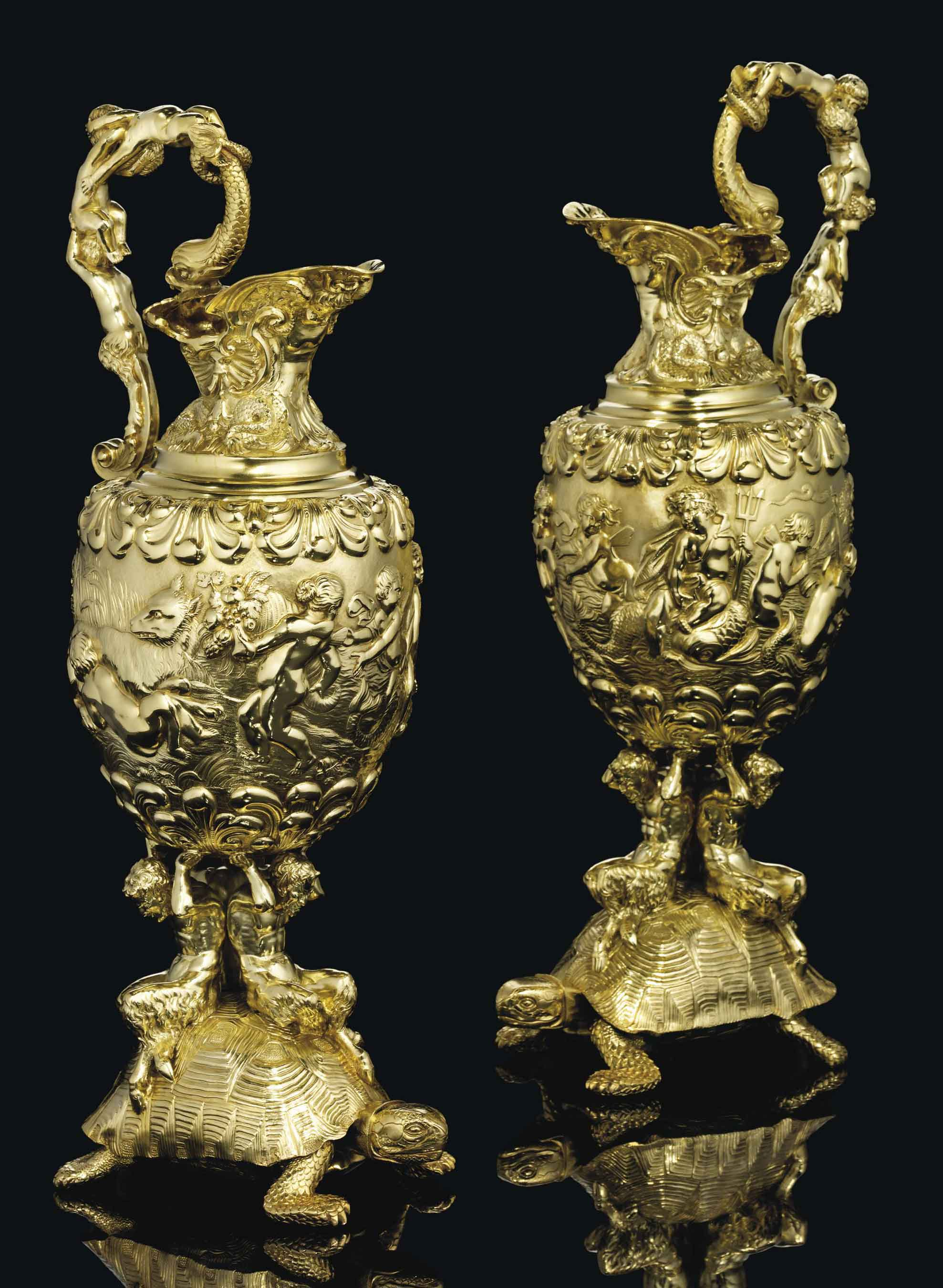 A PAIR OF GEORGE IV SILVER-GILT EWERS