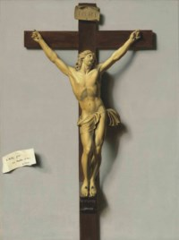 A trompe-l'oeil of an ivory and wood crucifix hanging on a wall