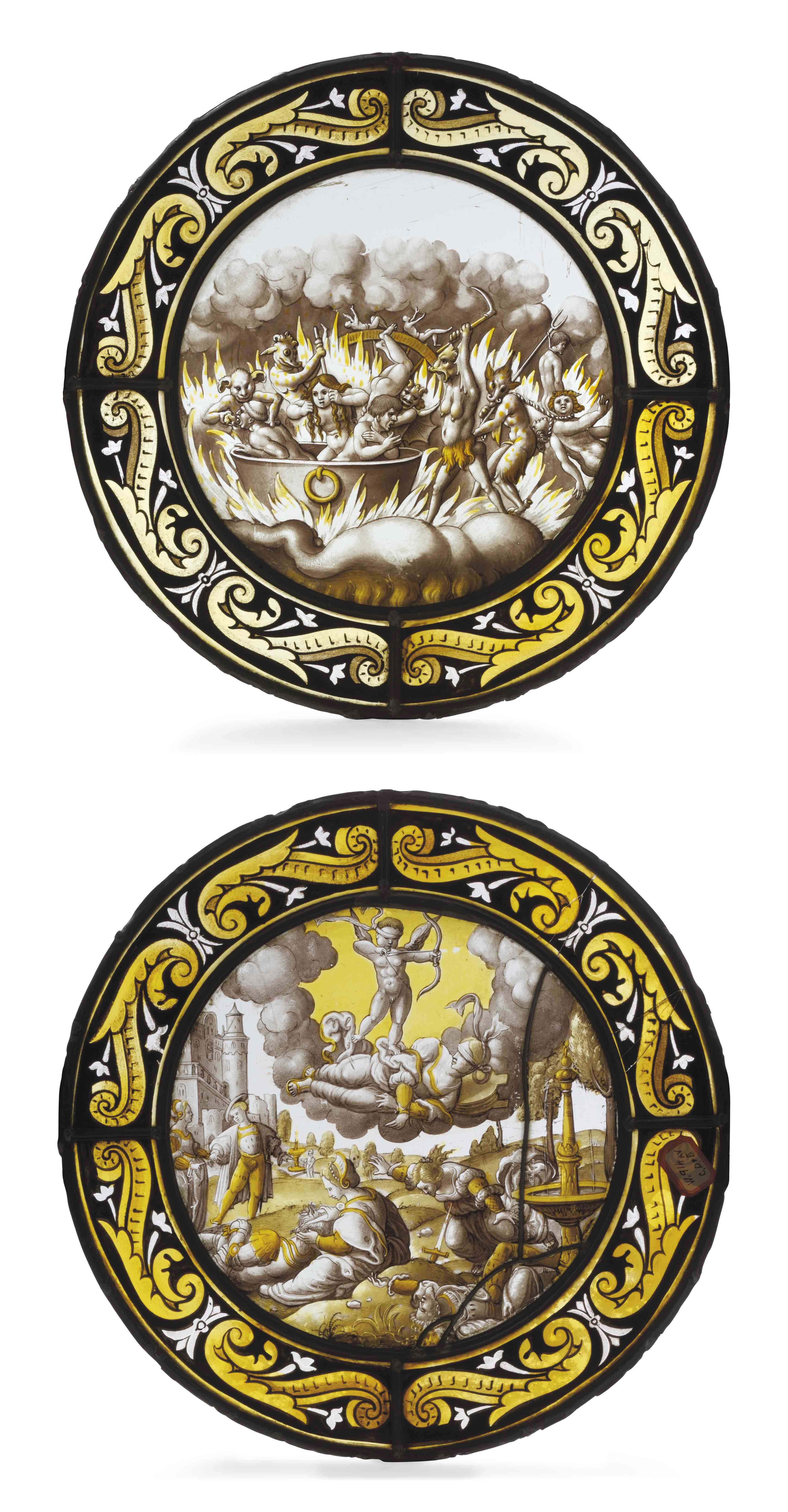 A PAIR OF STAINED GLASS ROUNDE