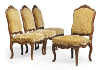 A SET OF FOUR LOUIS XV CARVED WALNUT SIDE CHAIRS