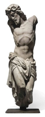 A FRAGMENTARY CARVED STONE FIG