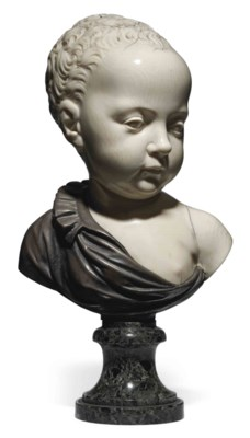 A CARVED IVORY AND SILVER BUST