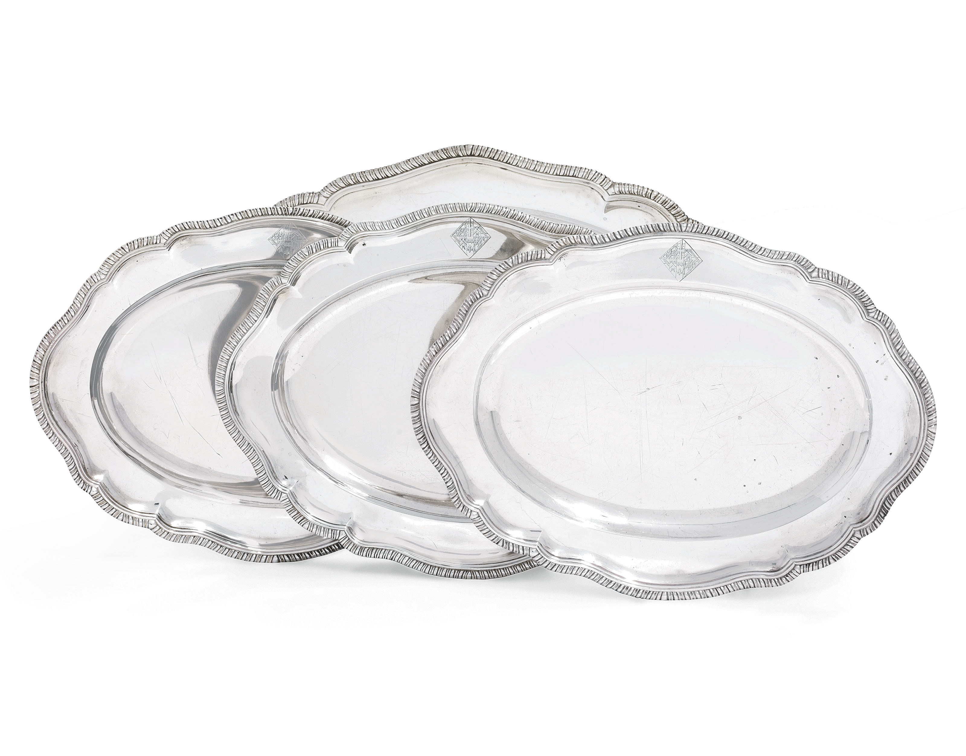 A PAIR OF GEORGE III SILVER MEAT-DISHES, ANOTHER SIMILAR AND A GEORGE II IRISH SILVER MEAT DISH