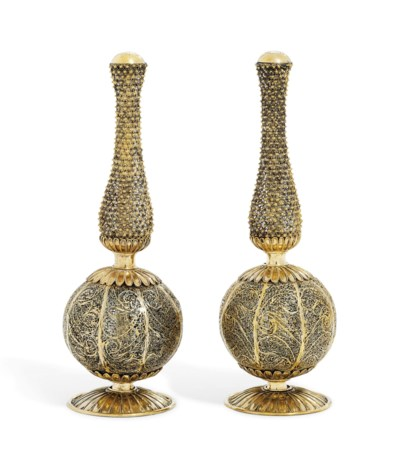 A PAIR OF INDIAN SILVER-GILT F