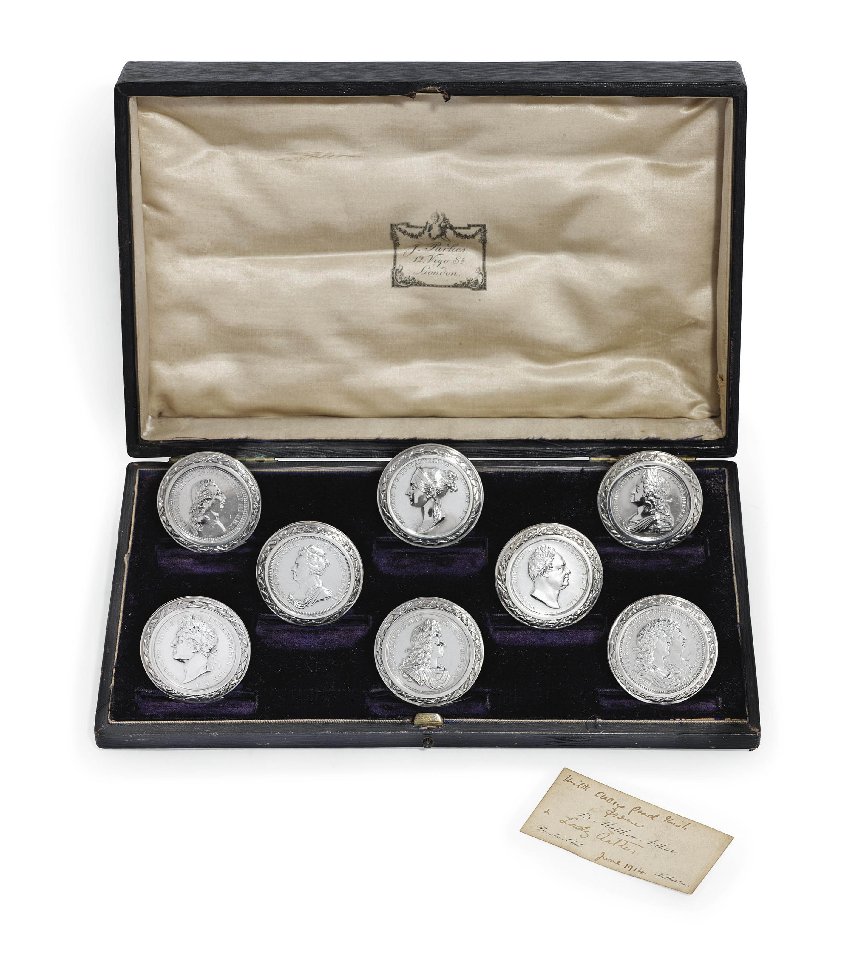 A SET OF EIGHT GEORGE V SILVER MENU-HOLDERS