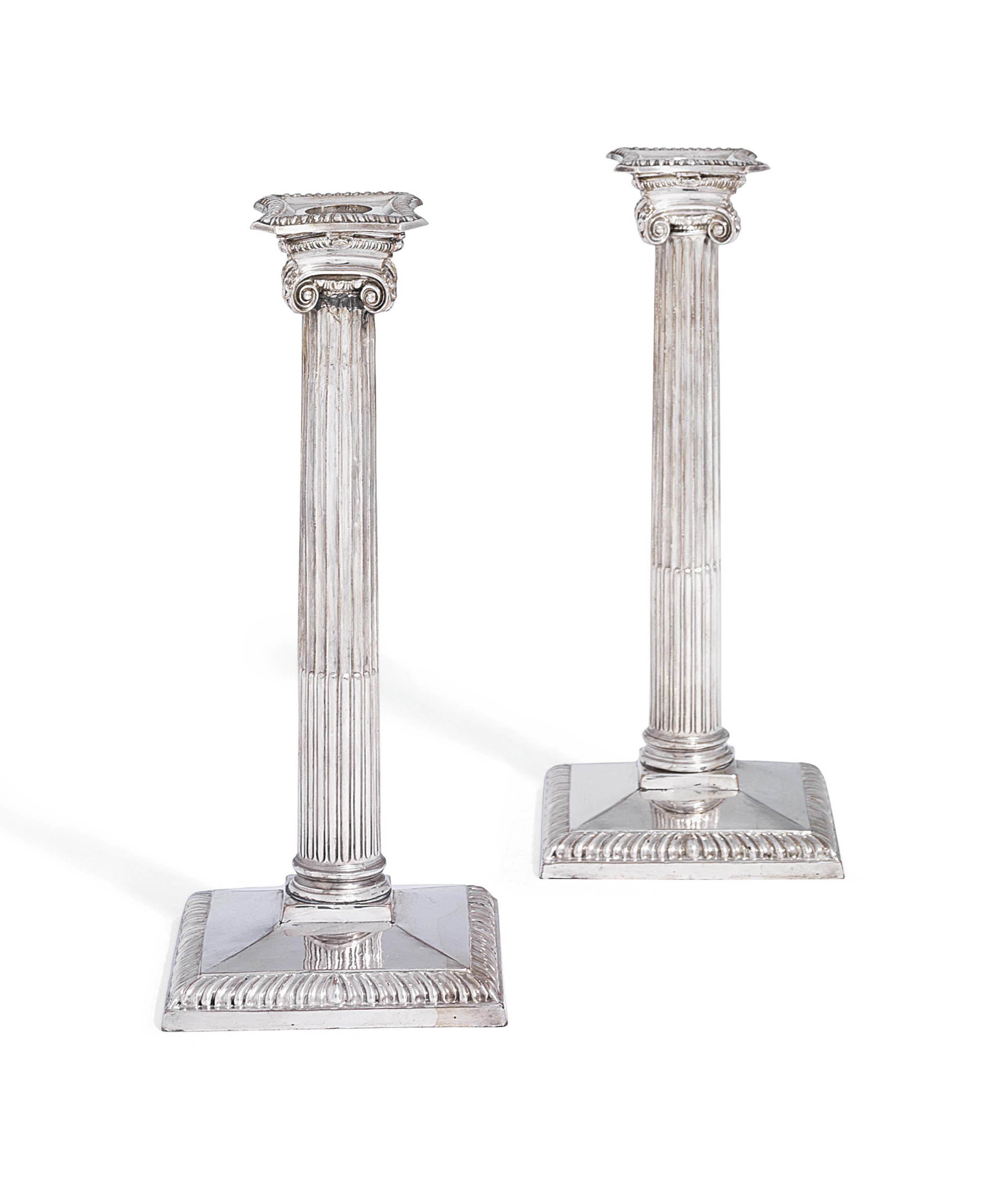 A PAIR OF GEORGE III OLD SHEFFIELD PLATE CANDLESTICKS