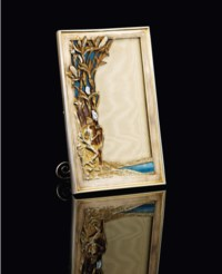 A JEWELLED SILVER-GILT AND ENAMEL PHOTOGRAPH FRAME