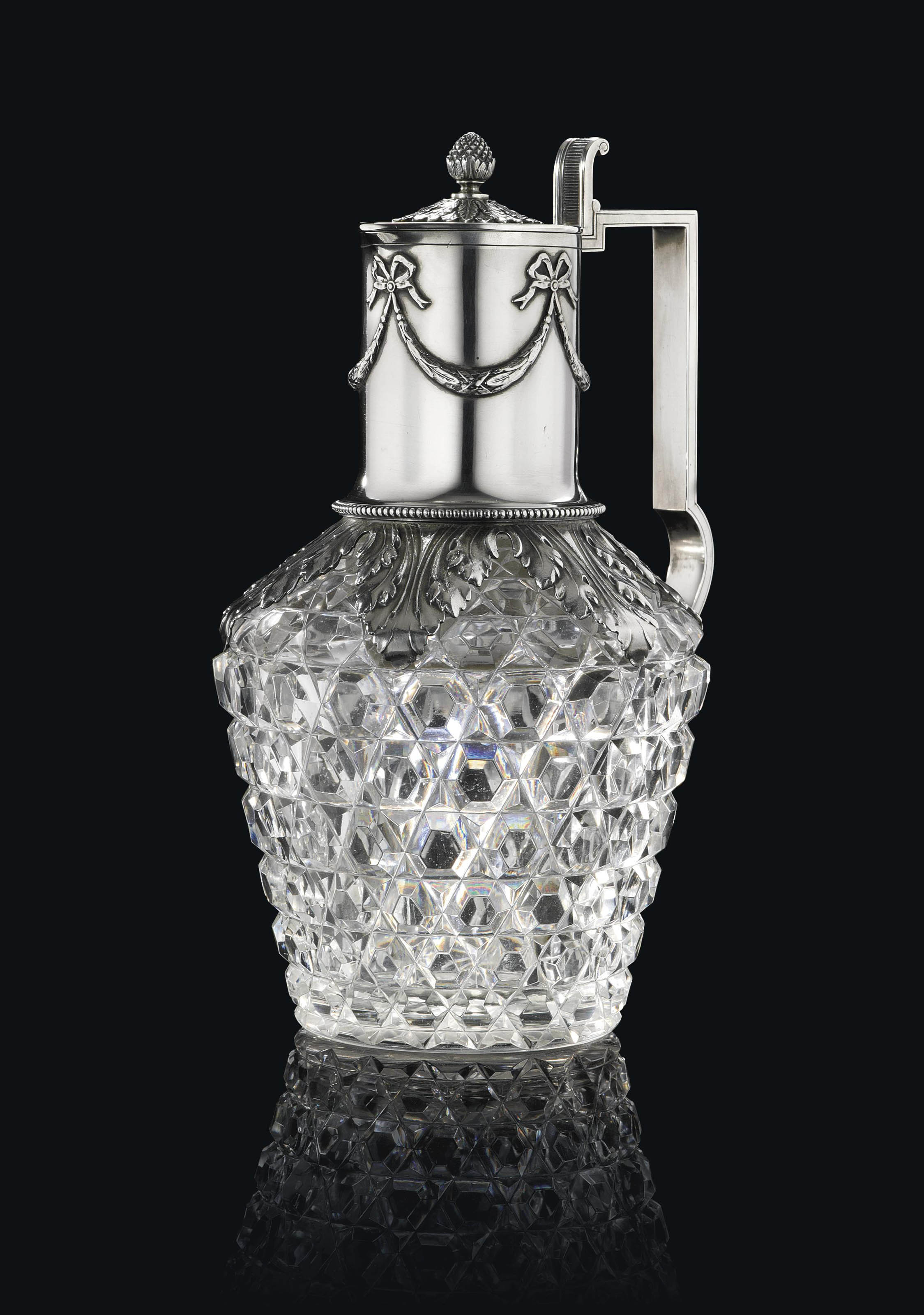 A SILVER-MOUNTED CUT-GLASS DECANTER