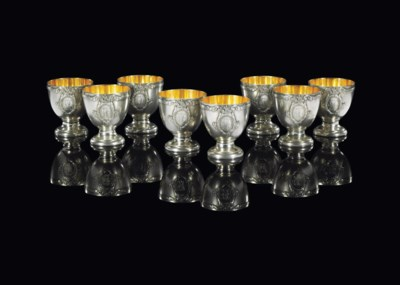 A SET OF EIGHT SILVER EGG CUPS