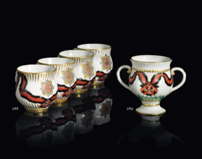 A PORCELAIN TWO-HANDLED CUP FR