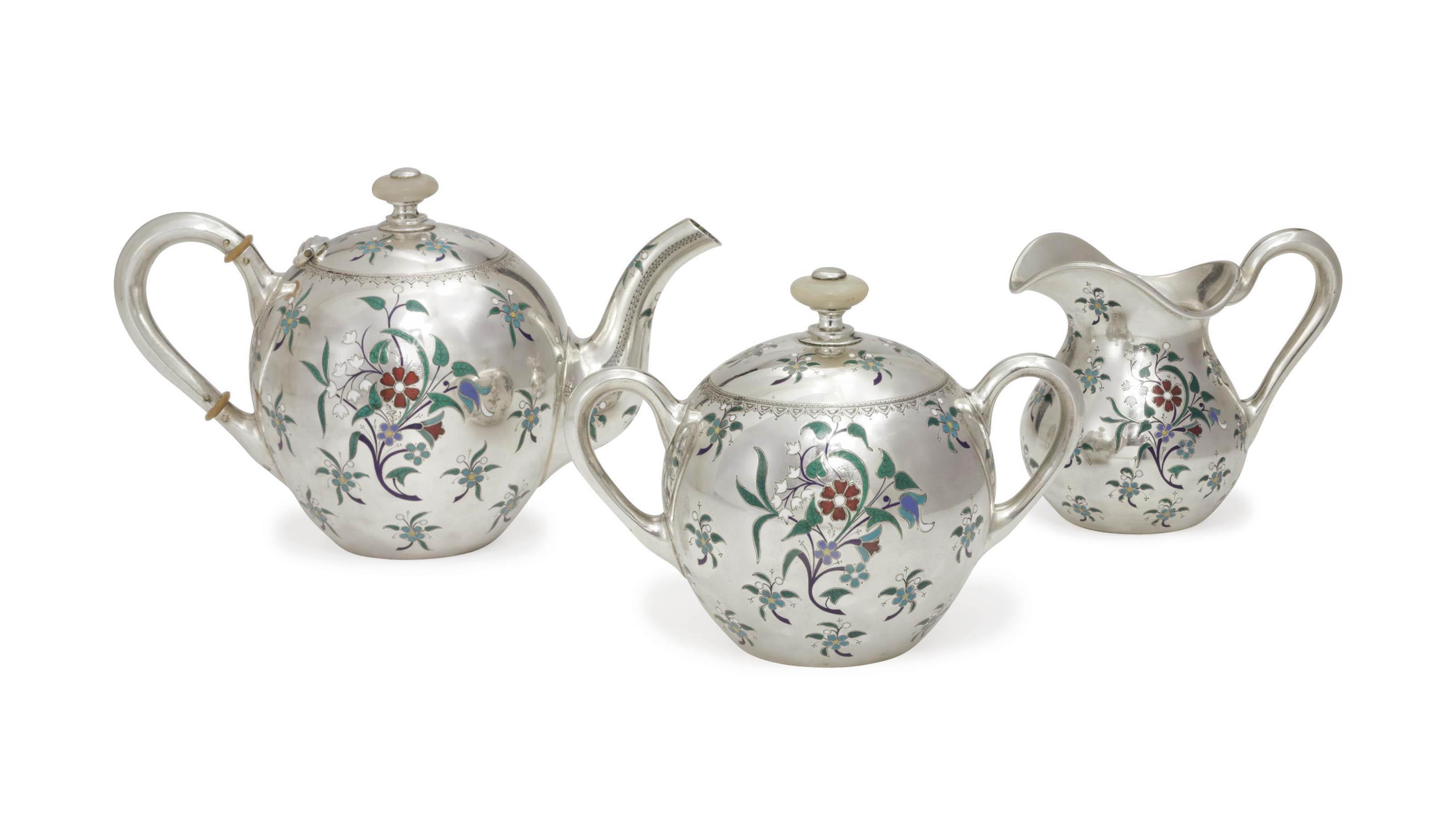 A SILVER AND CHAMPLEVÉ ENAMEL THREE-PIECE TEA SET