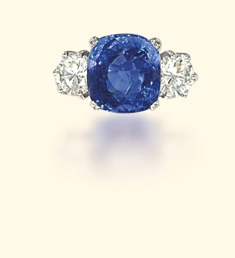 A PLATINUM AND SAPPHIRE RING