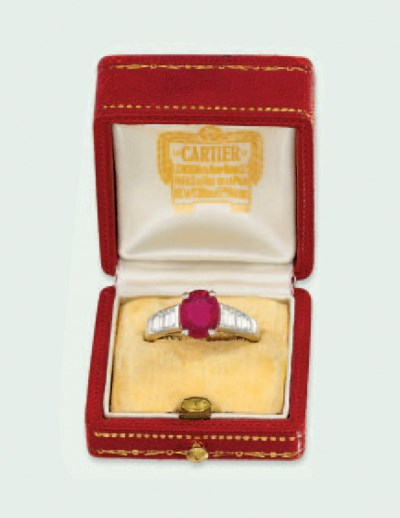 AN 18 CARAT GOLD RUBY AND DIAM