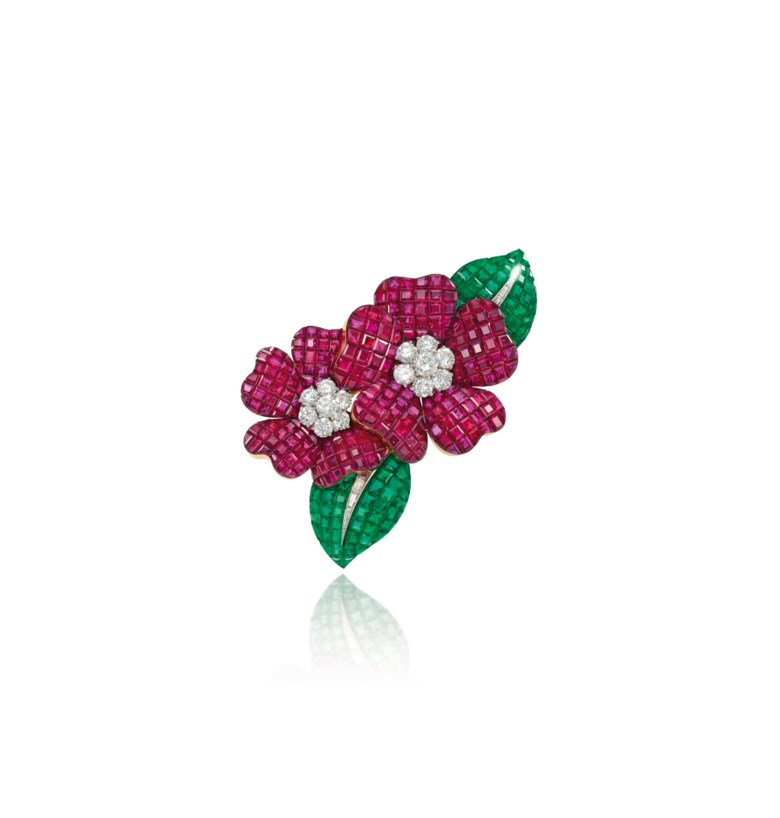A Mystery Set ruby, emerald and diamond Deux Fleurs clip brooch, by Van Cleef & Arpels. Sold for £235,250 on 29 November 2011  at Christie's in London