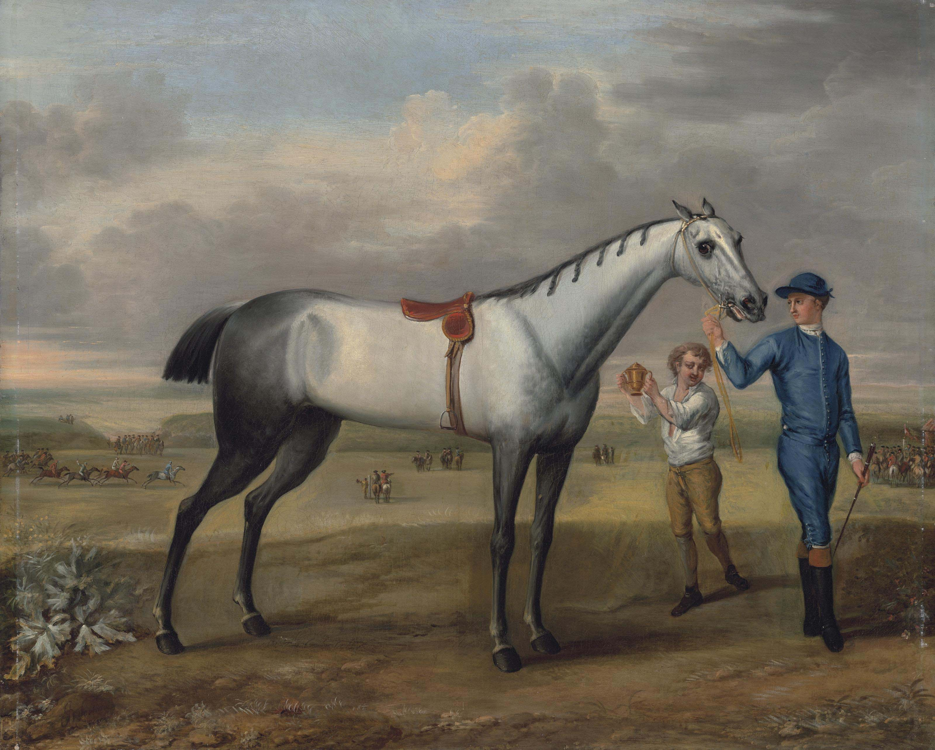 A grey racehorse held by a jockey, with a lad holding up a gold cup, at Newmarket