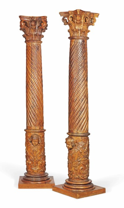 A PAIR OF CARVED ELM COLUMNS