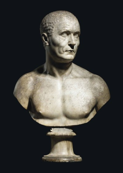 A CARVED MARBLE BUST OF A MAN