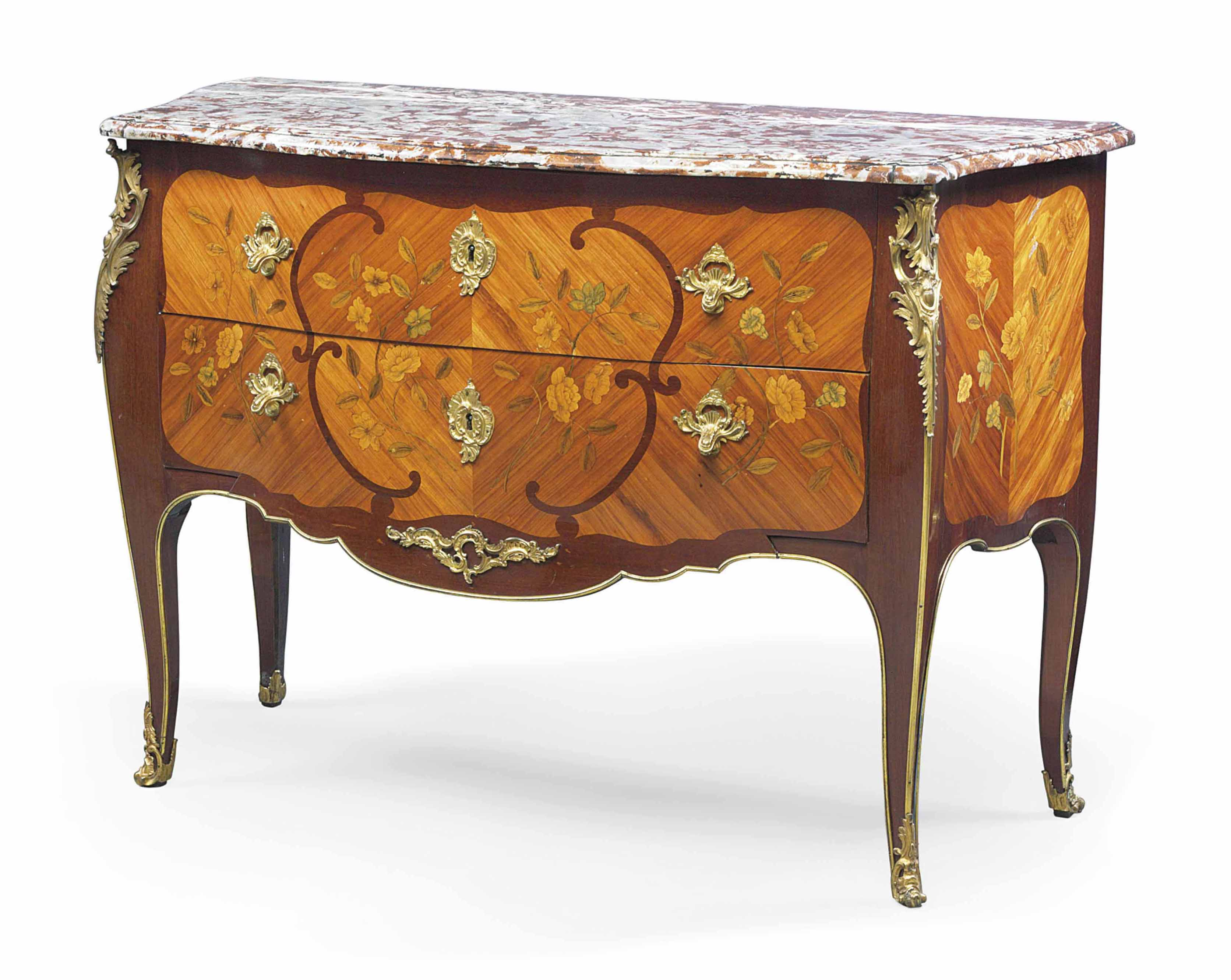 A LOUIS XV ORMOLU-MOUNTED AMARANTH, TULIPWOOD AND FLORAL MARQUETRY COMMODE