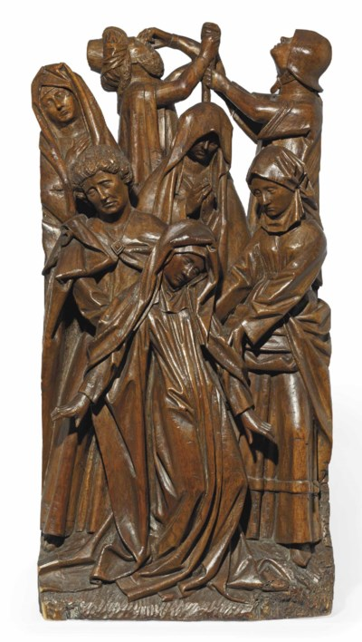 A CARVED OAK RELIEF OF THE SWO